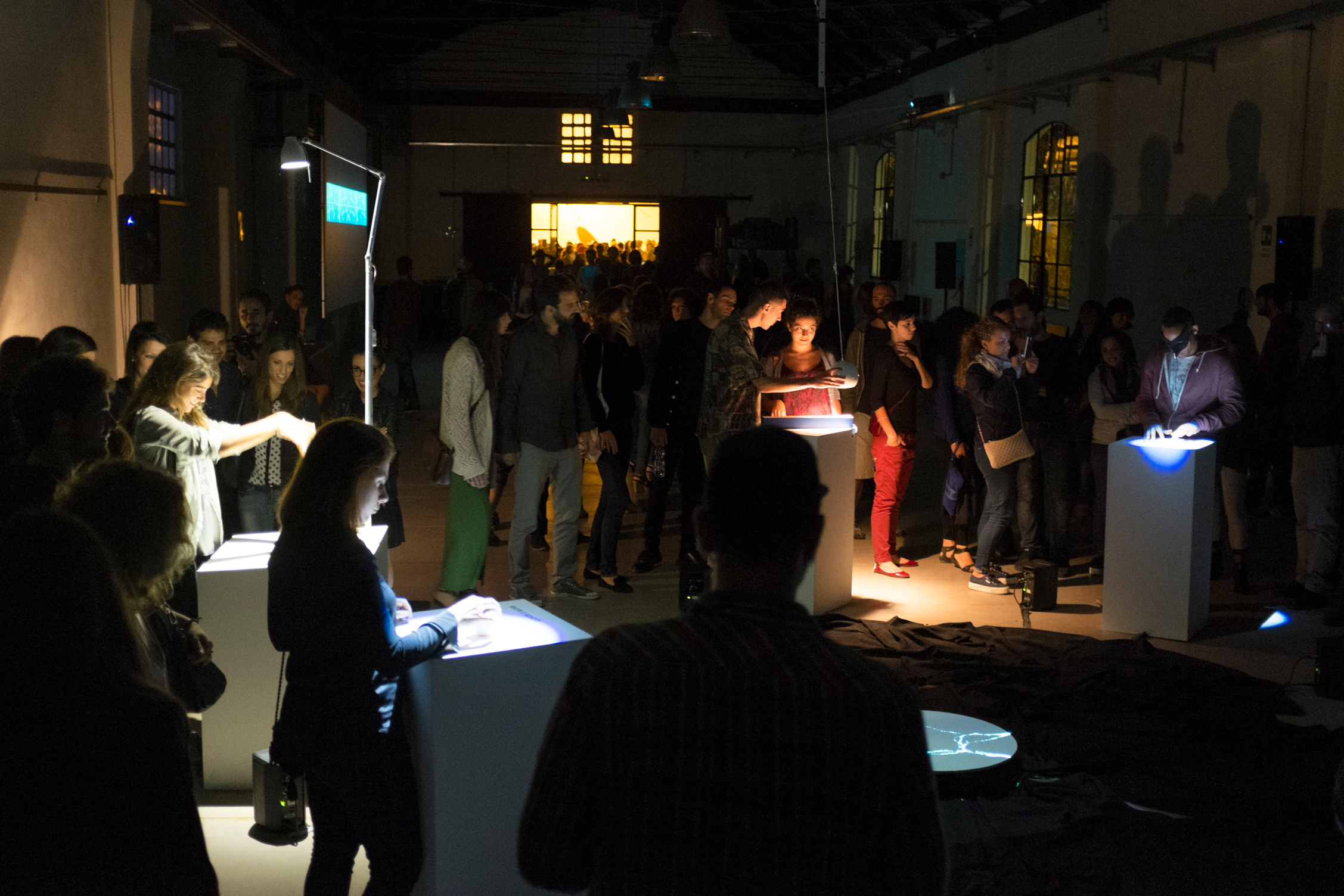 The Cave of Sounds by Tim Murray-Browne and members of Music Hackspace. Audiences playing with the interactive sound installation of digital musical instruments using movement, shadow, light and touch at 90dB Festival of the Sonic Arts Award, Rome, Sep 2014.
