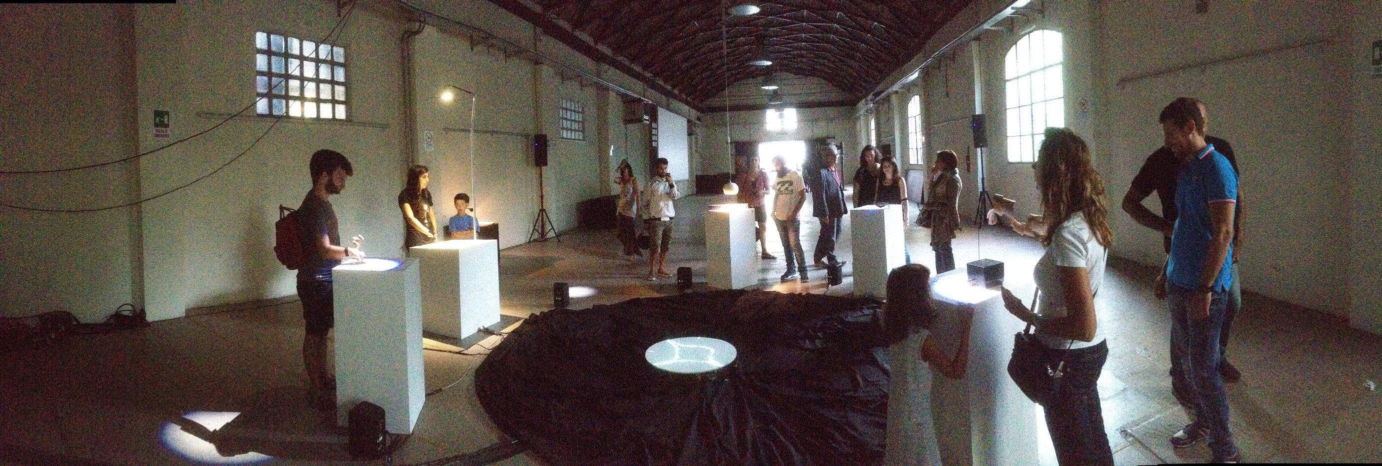 The Cave of Sounds by Tim Murray-Browne and members of Music Hackspace. Audiences and children playing with the interactive sound installation of digital musical instruments using movement, shadow, light and touch at 90dB Festival of the Sonic Arts Award, Rome, Sep 2014.