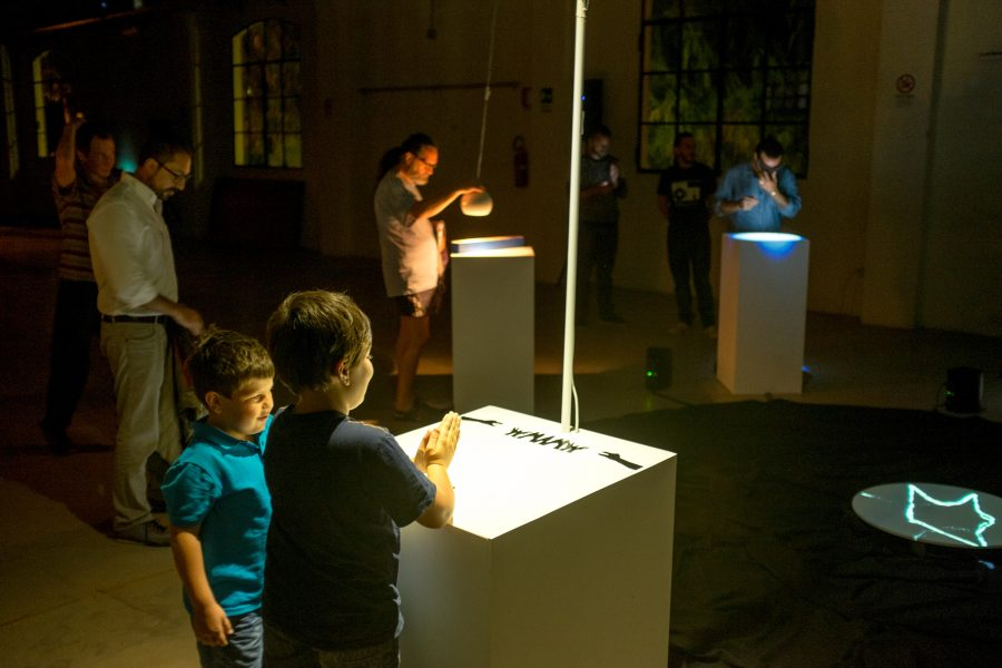 The Cave of Sounds by Tim Murray-Browne and members of Music Hackspace. The Animal Kingdom, a digital musical instrument played by casting shadows with your hands. Children and adults playing while exhibited at 90dB Festival in Rome as part of the Sonic Arts Award, Sep 2014.
