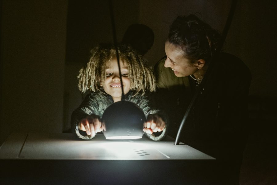 A child participates with Cave of Sounds, creating music by shining a light. Photo by Suzi Corker taken at Music Hackspace, Somerset House Studios, Jan 2018