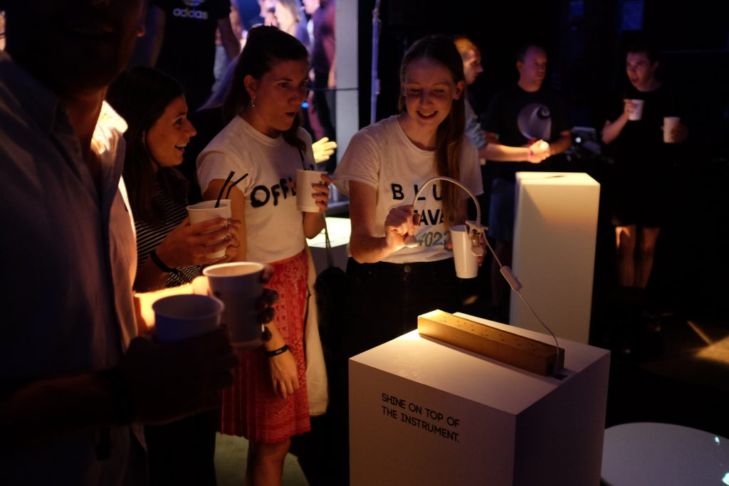 Participants create music together with Lightefface, a Cave of Sounds instrument played by shining lights onto a bed of sensors. Prototype exhibition at Village Underground, London, 2016. Photo: Tim Murray-Browne