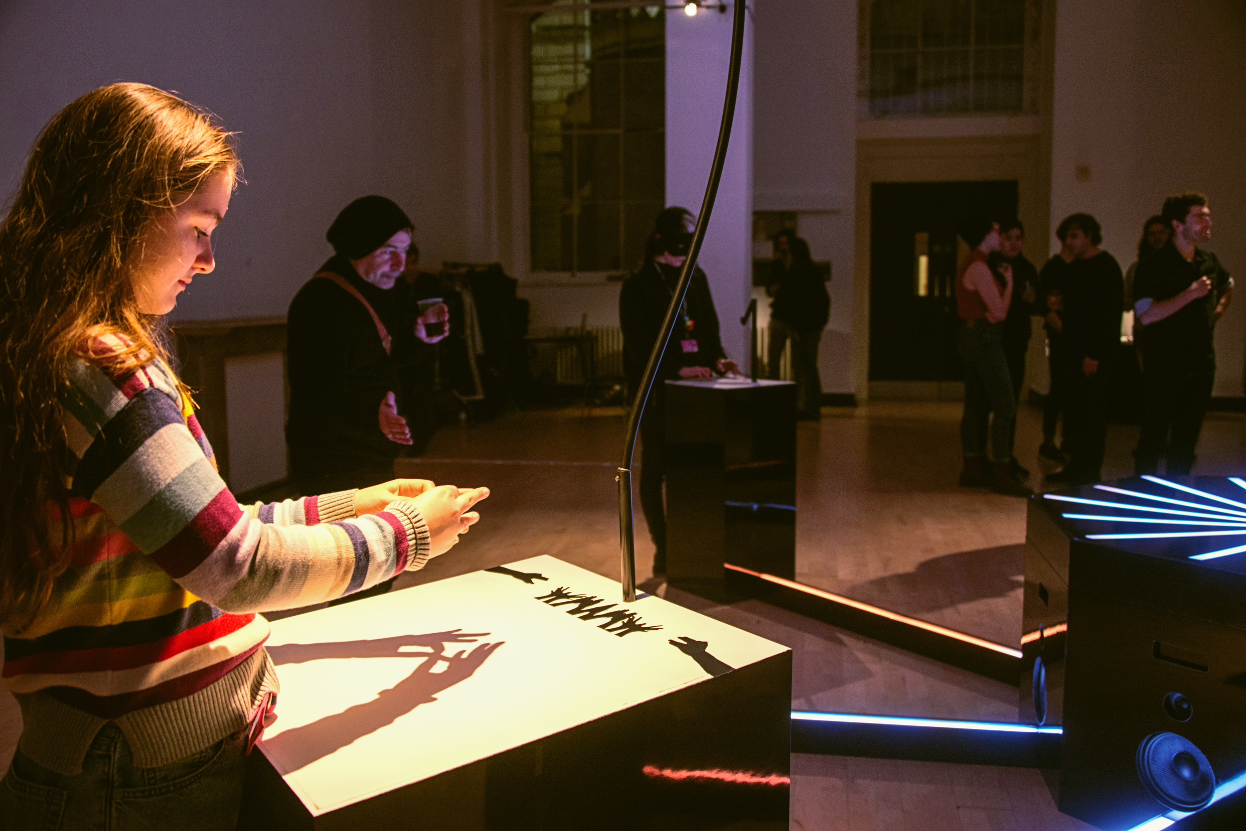 A child participant creates music by casting shadows with her hands using the Cave of Sounds instrument The Animal Kingdom, at Music Hackspace, Somerset House Studios, Jan 2018. Photo: Suzi Corker